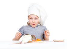 Chef girl preparing healthy food and pet rat Royalty Free Stock Photos