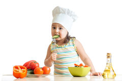 Chef girl preparing and tasting healthy food over Stock Image