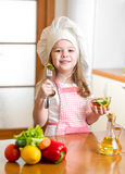 Chef girl tasting healthy food Stock Image