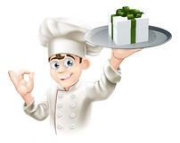 Chef giving gift Royalty Free Stock Image