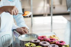 Chef Glazing donuts stock photos