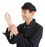 Chef with gloves. A chef putting on gloves to prepare food royalty free stock photo