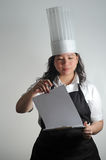 Chef going over cooking checklist Royalty Free Stock Image