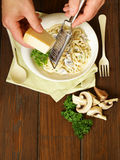 Chef grate parmesan cheese on pasta  carbonara Royalty Free Stock Images