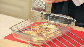 Chef Grating Cheese over Crispy Toasts stock footage