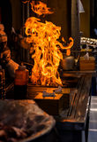 chef grilling bbq with flame of burning in restaurant Stock Photo