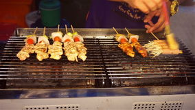 Chef grilling BBQ. At night market stock video footage