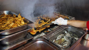 Chef Grilling Meat at Barbecue Dinner Buffet Royalty Free Stock Image