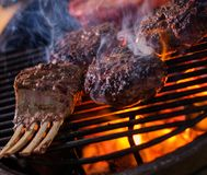Chef grilling ribs in a restaurant