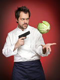 Chef with gun Royalty Free Stock Photography