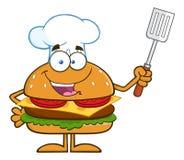Chef Hamburger Cartoon Character, das eine gekerbte Spachtel hält Lizenzfreie Stockfotografie