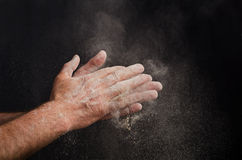 Chef Hand with flour on black royalty free stock photography