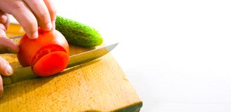 Chef Hand and Knife. Slicing Tomato royalty free stock images