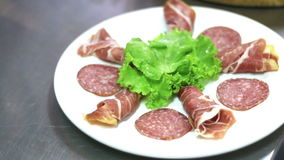 Chef hand perparing dry-cured ham and salami dish stock video footage