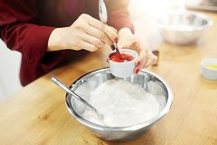 Free Chef Hands Adding Food Color Into Bowl With Flour Stock Photos - 113248913