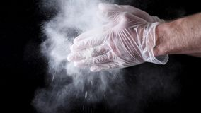 Chef Hands Clapping With Flour In Slow Motion on black background. Frame. Chef Claps Hands Together With Flour, Super. Slow Motion stock images