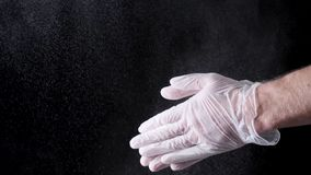 Chef Hands Clapping With Flour In Slow Motion on black background. Frame. Chef Claps Hands Together With Flour, Super. Slow Motion royalty free stock images