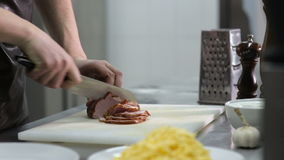 Chef hands cuts ham for Carbonara stock video footage