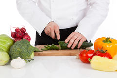 Chef hands cutting cucumber Stock Image