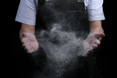 Chef hands in flour on black background. clap with flour. baking bread and and making pizza or pasta royalty free stock photography