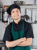 Chef With Hands Folded Standing In Kitchen Royalty Free Stock Photography