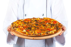 Chef in hands fresh pizza Royalty Free Stock Photo