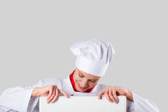 Chef hands holding white banner Stock Photo