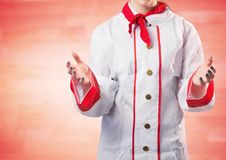 Chef with hands out against blurry red wood panel Royalty Free Stock Images