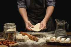 Chef hands are preparing a dough royalty free stock images