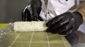 Chef hands preparing japanese food, chef making sushi, Preparing Sushi roll stock video footage