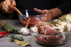 Chef hands preparing pork knuckle with sauerkraut and beer by chef hands, steps process on kitchen. text recipe stock photo