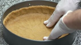 Chef hands pressing pie crust. stock video footage