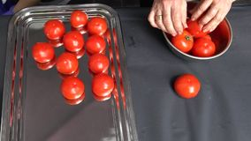 Chef hands put ripe tomatoes vegetables into steel dish. Slow motion shot. Chef hands put ripe tomatoes vegetables into steel dish. Healthy nutrition concept stock video footage