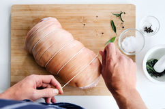 Chef hands with raw meat pork roast cooking preparation Royalty Free Stock Photos
