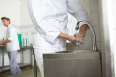 Chef hands washing hands. Chef hands washing his hands royalty free stock photography