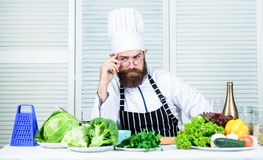 Chef handsome hipster. Get ready. Man bearded chef getting ready cooking delicious dish. Chef at work starting shift royalty free stock photos