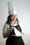 Chef happy with her cooking checklist Royalty Free Stock Photography