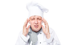 Chef has a migraine, emotional portrait on a white. Background Stock Image