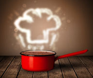 Chef hat above cooking pot Royalty Free Stock Photos