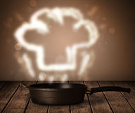 Chef hat above cooking pot Royalty Free Stock Image