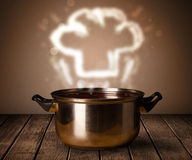 Chef hat above cooking pot Stock Photo