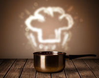 Chef hat above cooking pot Royalty Free Stock Photography
