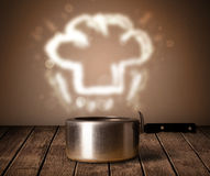 Chef hat above cooking pot Stock Images