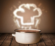Chef hat above cooking pot Royalty Free Stock Images