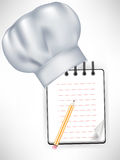 Chef hat with recipe notebook. And pencil Stock Photo