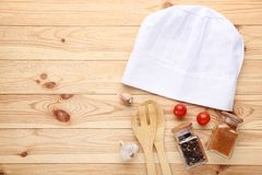 Chef hat with spices in jars royalty free stock image