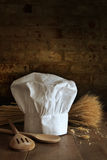 Chef hat and spoons with brick background Royalty Free Stock Images