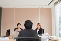 Meeting with chef. Chef having meeting with his female employees stock photos