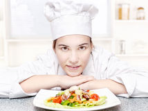 Chef and hers plate of salad in kitchen Stock Image