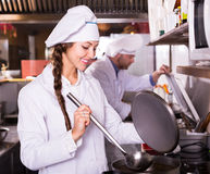 Chef and his helper at bistro kitchen Stock Photography